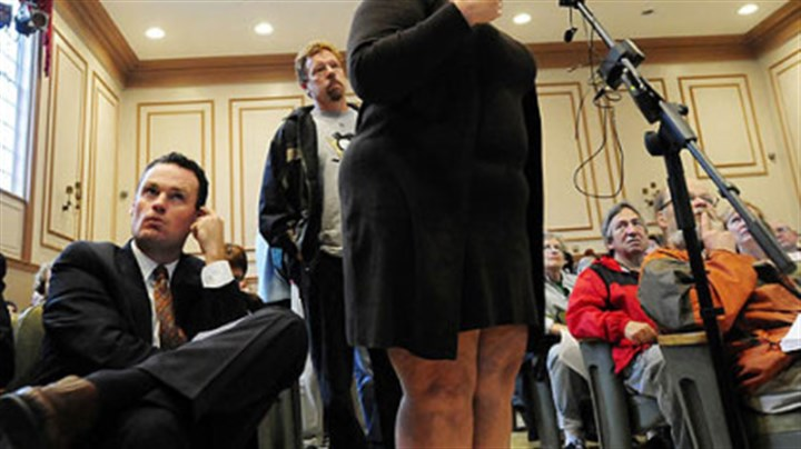 Flood hearing Mayor Luke Ravenstahl, left, listens as Elizabeth Beroes of Shadyside talks about 8 feet of water that flooded her basement in 2009. The community hearing on East End flooding was held Tuesday at Winchester Thurston School in Shadyside.