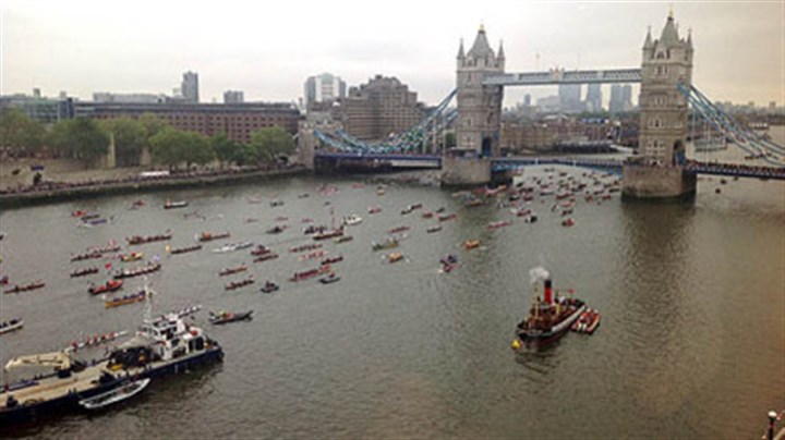 Flotilla An armada of more than a thousand skiffs, dhows, tugboats and other motorcraft move down the Thames under London Bridge in a flotilla celebrating Queen Elizabeth II's Diamond Jubilee.