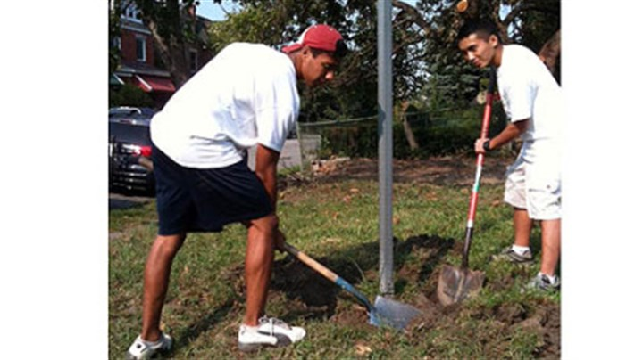 Flower garden Daniel Denlinger, left, and friend Quoc Vo help carve out a flower garden in Homewood.