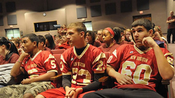 football team Three members of the junior high football team from New Brighton Middle School, left-right Robert Gibbons, 14, Brendon Duschene, 14, and Matthew Hall, 14, wait for the start of a program about Rachel's Challenge, created to use the life and writings of Rachel Joy Scott, who was the first victim in the 1999 Columbine school shootings, to encourage people to treat each other with respect.