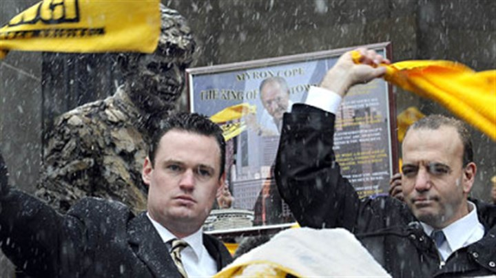 For Myron Pittsburgh Mayor Luke Ravenstahl, left, and Allegheny County Chief Executive Dan Onorato wave their Terrible Towels in honor of Myron Cope at a rally at the City-County Building today.