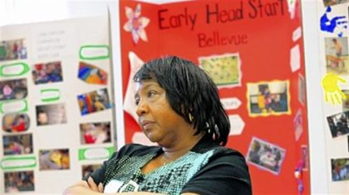 Forum on kindergarten Betty Moore, an educator at Shady Lane School in Point Breeze, sitting in front of posters made by various kindergarteners, listens to speakers at a Childhood Education Forum dealing with proposed state budget cuts at the pre-K and kindergarten levels at AIU headquarters in Homestead.