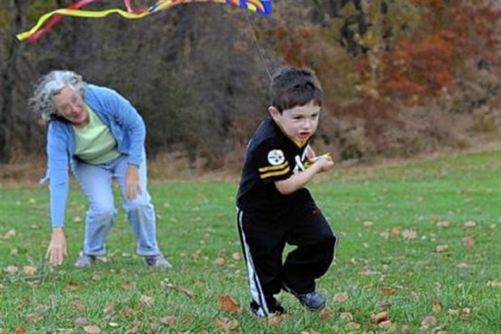 frick park Joey McGivney, 4, flies a kite with his nanny, Mary Jo Week, in Frick Park.