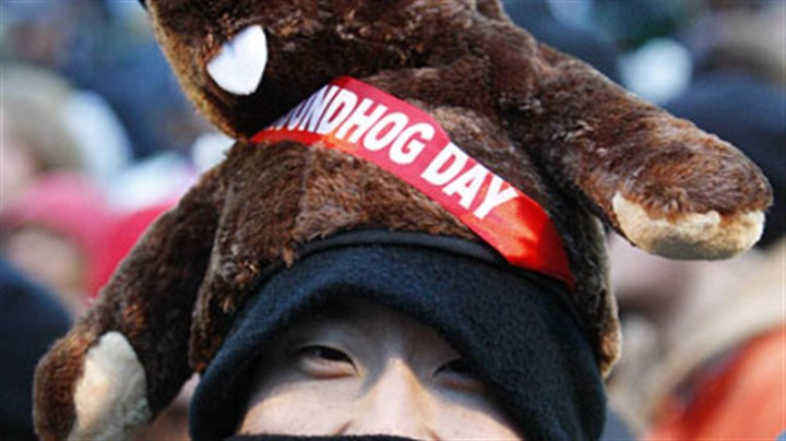 From the Big Apple Charles Lim, of New York City, braves the weather on Gobbler's Knob to watch Punxsutawney Phil.