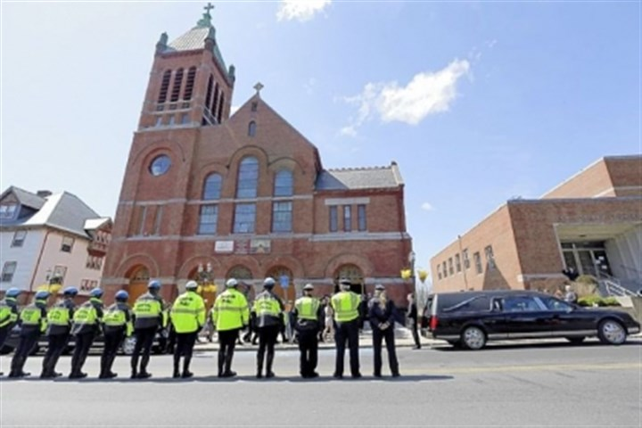 funeral boston bomb victim Medford and Somerville police line the street outside St. Joseph's Church in Medford, Mass. today for the funeral of Boston Marathon bomb victim Krystle Campbell, 29.