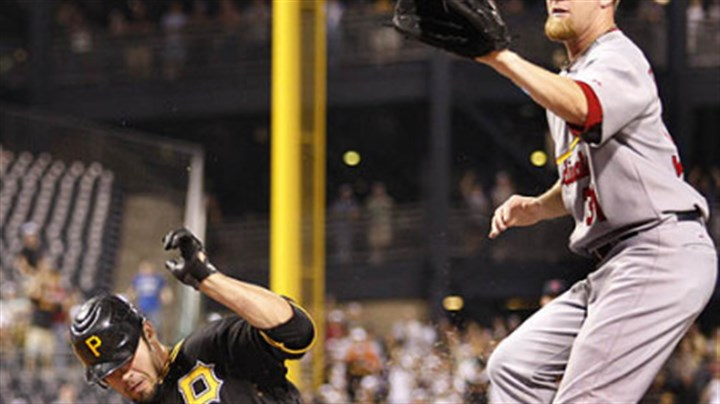 Garrett Jones and Ryan Franklin The Pirates Garrett Jones scores to tie the game on a wild pitch by Cardinals pitcher Ryan Franklin during the eighth inning.