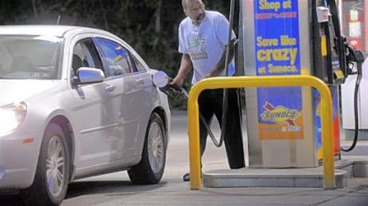 Gas A man pumps gas at Sunoco in McKeesport. Despite rising gas prices, people are still heading to the pumps.
