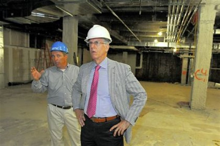 Geoff Leah Geoff Leah, left, project manager on the former Mellon Bank building on Smithfield Street, and Gary Saulson, executive vice president and director of corporate real estate at PNC, look at some of the work that is taking place at the site.