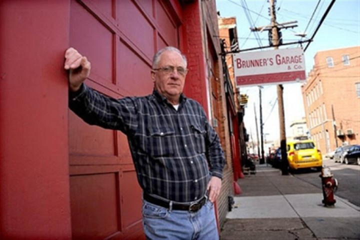 George Dorfner George Dorfner, owner of Brunner's Garage on the South Side since 1968, is just one of several business owners affected by permit parking. He says the neighborhood's parking issues may force him to retire.