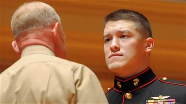 Gerardi Maj. Gen. Melvin G. Spiese, left, congratulates Marine Sgt. David M. Gerardi after awarding him the Silver Star Medal for valor for action in Afghanistan during ceremonies at the Soldiers & Sailors Hall and Museum on Monday.