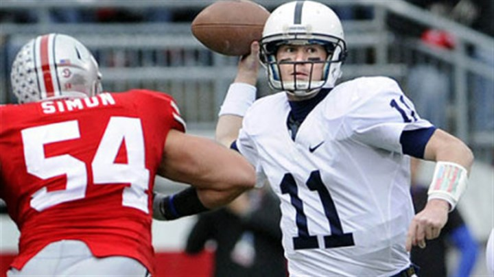 Going for a pass Penn State quarterback Matt McGloin looks to pass as Ohio State's John Simon closes in.