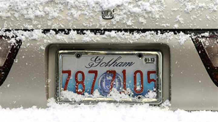 "Gotham license plate Snow-covered cars on Oliver Avenue sport Gotham license plates as ""The Dark Knight Rises"" films in Downtown Pittsburgh."