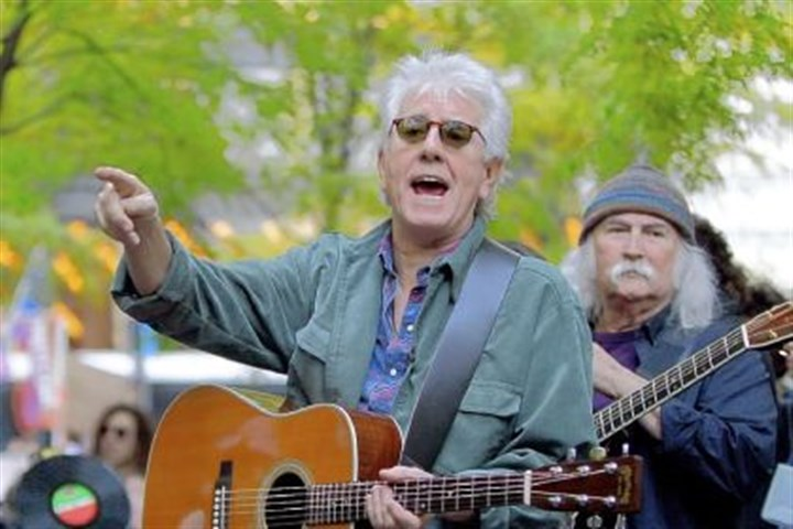 Graham Nash and David Crosby Graham Nash, left, and musical partner David Crosby perform protest songs at Occupy Wall Street's Zuccotti Park encampment in New York in 2011.