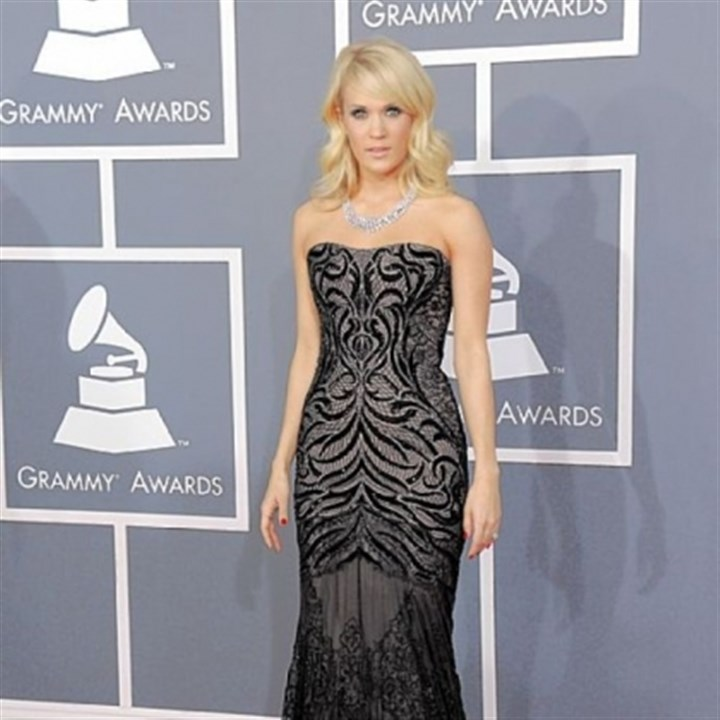 Grammy fashion Carrie Underwood in a Roberto Cavalli gown at the 55th annual Grammy Awards.