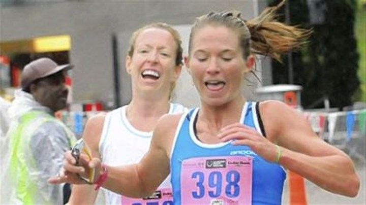 Great Race Sara Raschiatore of Pittsburgh edges Roberta Groner of Irwin at the tape to win the 10k women''s division at the 35th Great Race in Point State Park on Sunday. Both recorded at time of 34 minutes, 46 seconds.