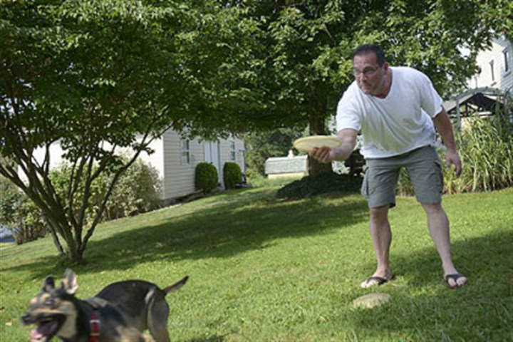 grieco3 Bill Grieco, 51, of Cheswick plays with his dog Elsa in his backyard on Aug. 26. Mr. Grieco has struggled with depression and drinking and has gotten in trouble with the law.