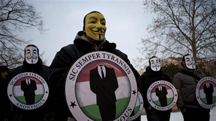 Hacker group members arrested Masked protesters held the logos of the international computer hacker group Anonymous during a demonstration Feb. 11 in Budapest, Hungary. The hacker community was rocked by the news yesterday that one of the world's most-wanted computer vandals has been an FBI informant for months.