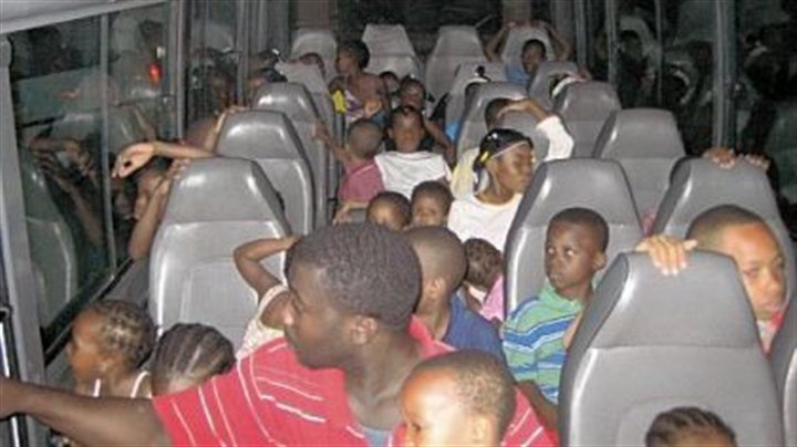 Haiti 1 The Haitian children on the bus during their journey to the United States.