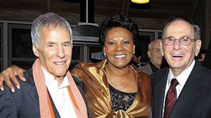 "Hal David An Oct. 17, 2011, photo shows songwriters Bert Bacharach, left, and Hal David with singer Dionne Warwick at the ""Love, Sweet Love"" musical tribute to Mr. David on his 90th birthday in Los Angeles. Mr. David died Saturday in Los Angeles."