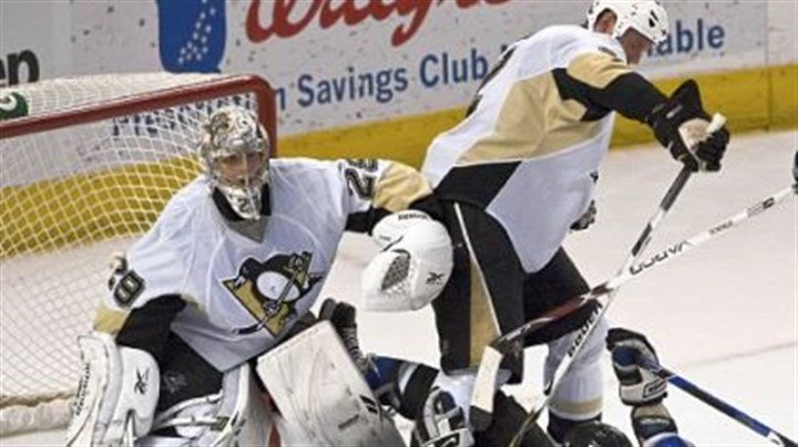 Hal Gill Hal Gill, right, helps clear Tampa's Zenon Konopka from in front of Marc-Andre Fleury last night in Tampa, Fla.