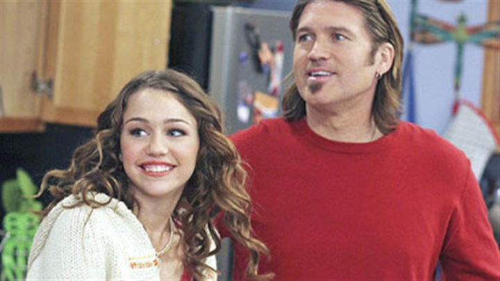 """Hannah Montana"" Miley Cyrus, left, and her father, country music singer Billy Ray Cyrus, in a scene from the ""Hannah Montana"" TV show."
