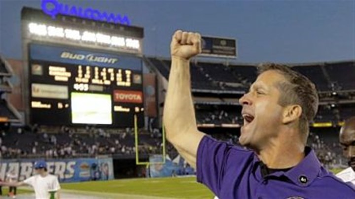harbaugh Baltimore coach John Harbaugh celebrates last week in San Diego.