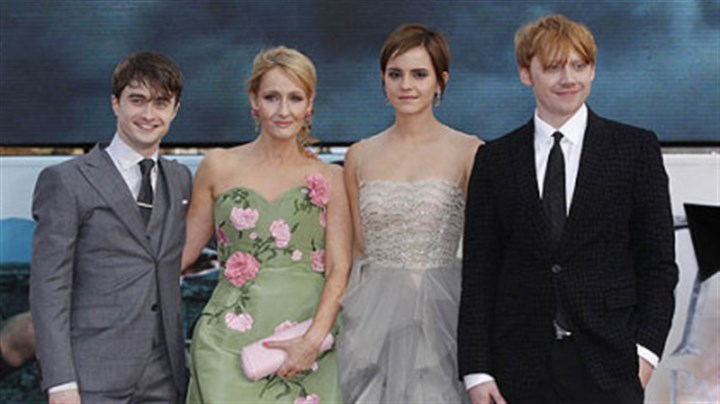 "Harry Potter author and cast Author J.K. Rowling, second left, joins actors Daniel Radcliffe, Emma Watson and Rupert Grint July 7 in London's Trafalgar Square for the world premiere of ""Harry Potter and the Deathly Hallows, Part 2"" the last film in the series."