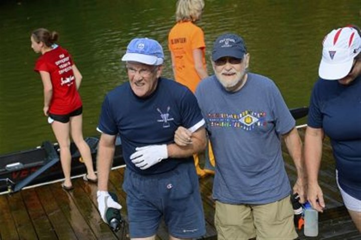 Head of the Ohio Bruce Cooper, left, 70, of Wexford helps Jack Harnick, 83, of Hampton off the dock after participating in the 2013 Head of the Ohio race on Saturday.