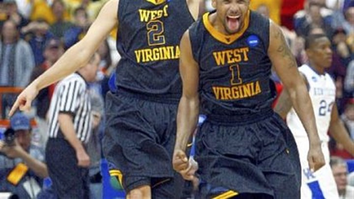 Headed to the Final Four Da'Sean Butler, right, and teammate Cam Thoroughman run around the court as the realization sets in that West Virginia is headed to the Final Four.