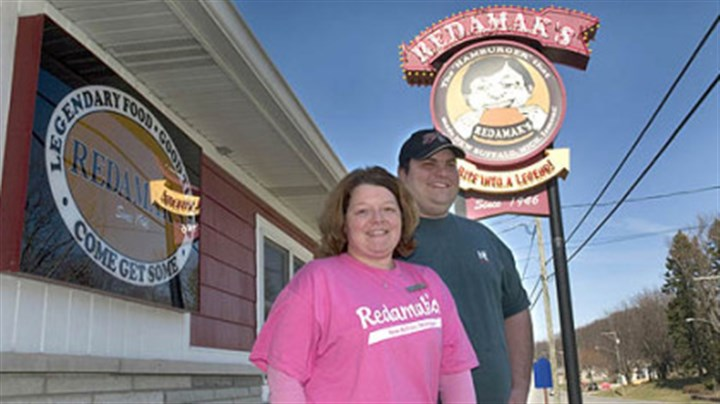 Heidi and Charlie Maroney stand outside Redamak's, a popular restaurant in New Buffalo, Mich. Heidi and Charlie Maroney stand outside Redamak's, a popular restaurant in New Buffalo, Mich. , where they both work. His grandparents, Jim and Angie Maroney, bought the business in 1975.