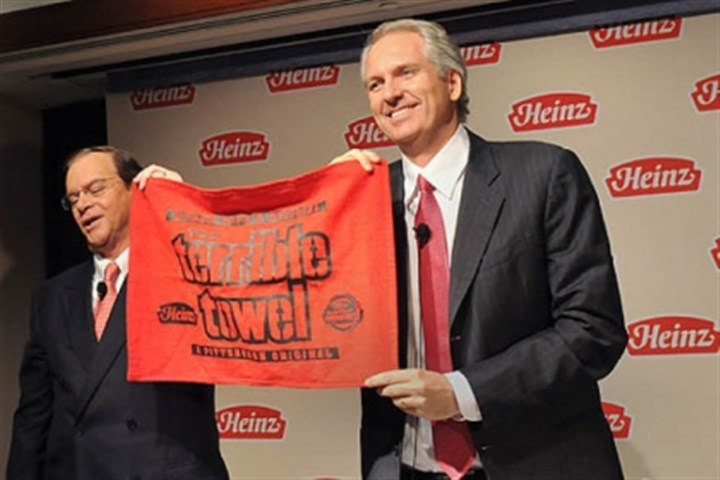 heinz chairman terrible towel At a press conference held February 14, 2013 to announce that H. J. Heinz Company is to be acquired by Berkshire Hathaway and 3G Capital, Alex Behring, right, managing partner at 3G Capital, was presented with a Heinz red Terrible Towel by William R. Johnson, chairman, president and CEO of Heinz.