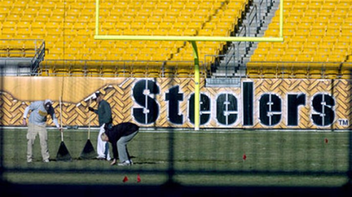 Heinz Field Staff members tend to Heinz Field yesterday to prepare it for Sunday's game with Cincinnati.