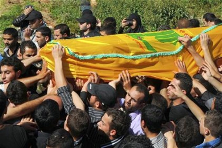 Hezbollah members carry coffin Members of Lebanon's Hezbollah Shiite Muslim movement carry the coffin of a comrade during his funeral in May in the village of Haret al-Fikani, in the Bekaa valley. The man was reportedly killed during the battle for Qusayr in neighboring Syria.
