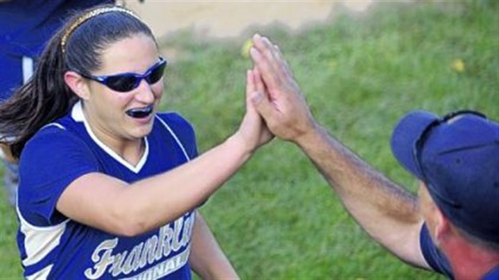 High-five Winning pitcher Ally Vrcek gets a high-five from Franklin Regional head coach Jim Armstrong.