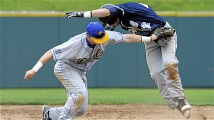 High school baseball Mt. Lebanon's Ian Happ tags out McDowell's Alex Margraf at second base Monday in the first round of the PIAA playoffs.