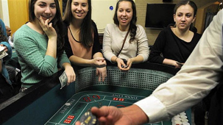 Hillel Jewish University Center From left, Rachael Fleisig, Jenna Goldstein, Rayna Levine and Rebecca Kastrenakes, all 18-year-old students at the University of Pittsburgh, shoot craps at the Hillel Jewish University Center in Oakland at a Hanukkah event Thursday. Proceeds helped victims of Hurricane Sandy.
