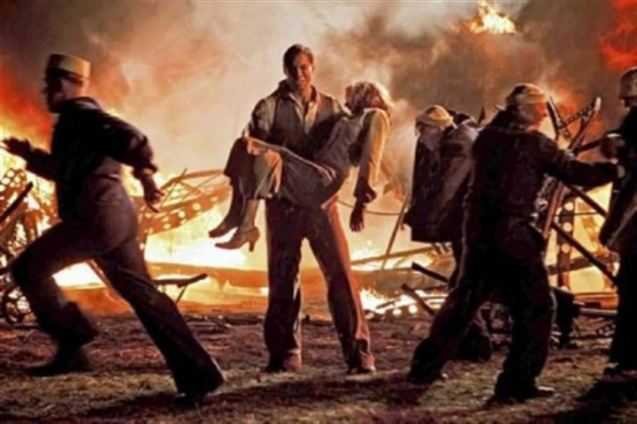 "'Hindenburg: The Last Flight' Maximilian Simonischek carries Lauren Lee Smith away from the Hindenburg crash in the miniseries ""Hindenburg: The Last Flight,"" airing at 8 p.m. Monday and Tuesday on Encore."