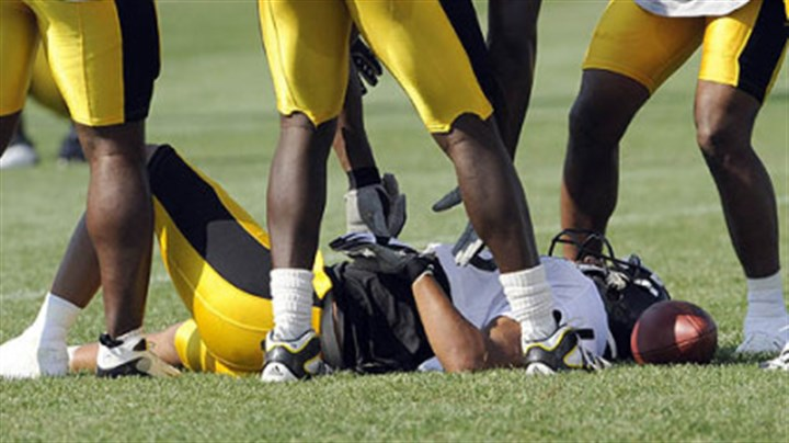 Hines Hines Ward is slow to get up after taking a hard hit from teammate Anthony Smith.