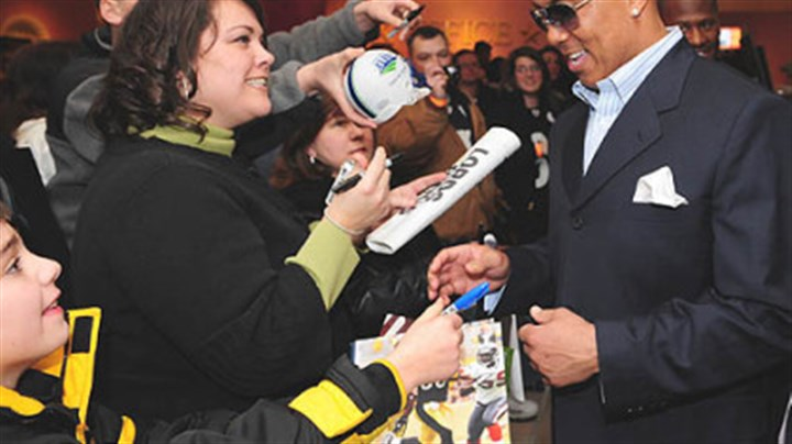 Hines Ward Hines Ward signs autographs before the debut of the NFL Films documentary on the Steelers' super season yesterday at the AMC Lowes Waterfront.