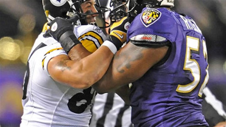 Hines Ward and Ray Lewis Hines Ward mixes it up with the Ravens Ray Lewis during a game earlier this season in Baltimore.