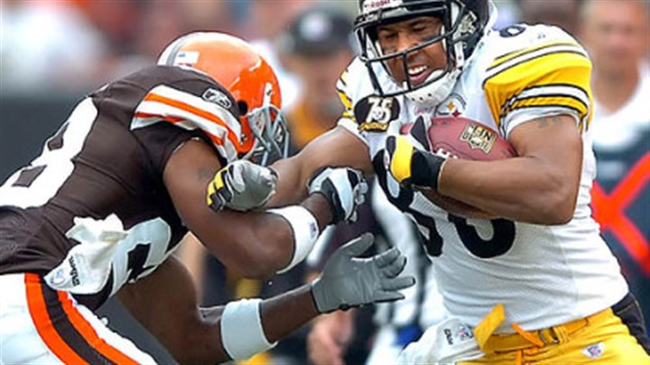 Hines Ward fights for extra Hines Ward fights for extra yardage against Browns defensive back Leigh Bodden in Sunday's win.