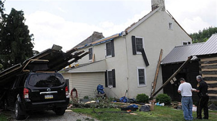 Home damage Public safety officials from Westmoreland County survey damage to the home of Steve and Tracey Pelesky in Ligonier on Saturday after a suspected tornado hit the area Friday.