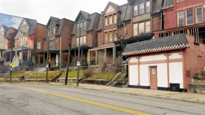 Home purchased by Pittsburgh Glass Center Pittsburgh Glass Center has purchased the former Kim's Coffee Shop, right, not far from the Bride of Penn Avenue mural, left.