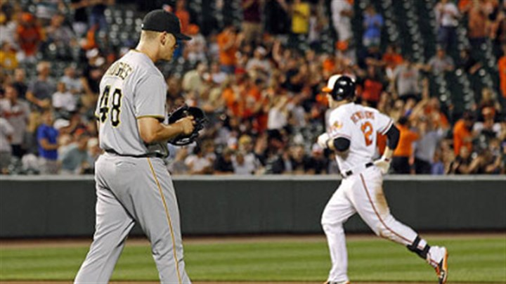 Home run Pirates relief pitcher Jared Hughes, left, walks to the mound as Orioles' Mark Reynolds rounds the bases after hitting a solo home run in the eighth inning.