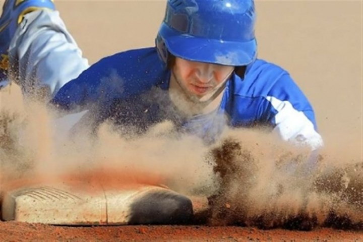 hsbaseball Hampton's Brandon Marsonek dives safely back to first base Monday against Seneca Valley. Seneca Valley won, 1-0.