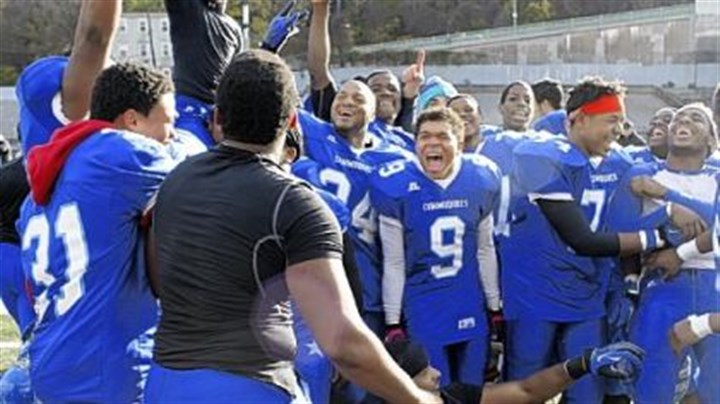 HScity The Perry High School football team celebrates after winning the City League football championship at Cupples Stadium on Saturday.