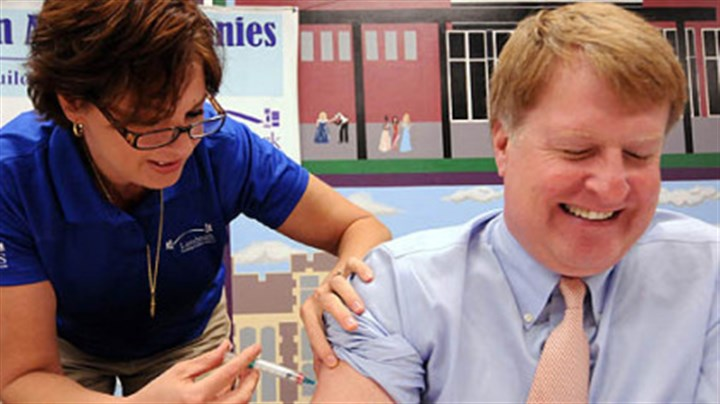 http://www.post-gazette.com/stories/uncategorized/uncategorized/free-clinic-kicks-off-flu-shot-season-653898/ Allegheny County Executive Rich Fitzgerald gets a flu shot from Kim Delp at an influenza and vaccination educational event today.