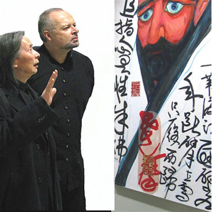 Huang poetry Huang Xiang and William Rock with their portait of Buddhist monk Bodhidharma at an exhibit in Manhattan.