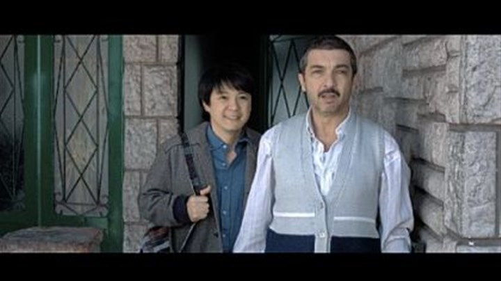 "Huang Sheng Huang, and Ricardo Darin Despite a language barrier, Huang Sheng Huang, left, and Ricardo Darin develop something of a friendship in ""Chinese Take-Away."""