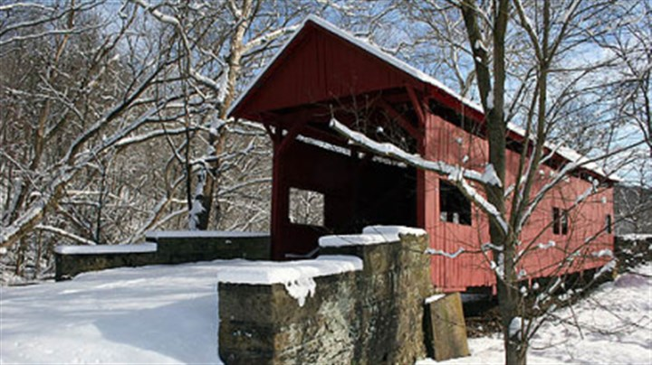 Hughes Covered Bridge The Hughes Covered Bridge in snow in 2009. The bridge now is used only for foot traffic. It stands just to the east of I-79 near the Marianna/Prosperity exit.